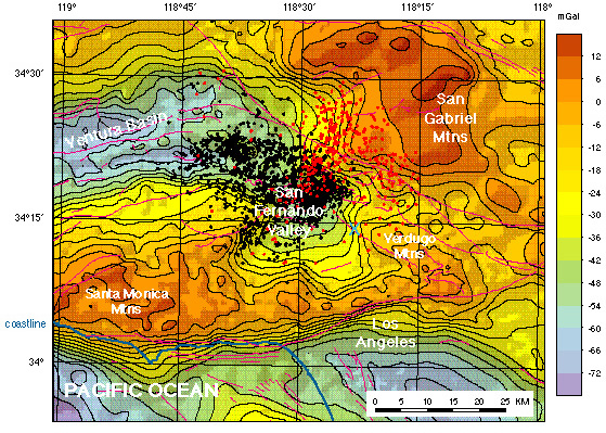 """Isostatic gravity map with 1994 (black circles) and 1971 (red circles) aftershock seismicity. The blue """"X"""" marks where the geophysical character of the Verdugo fault changes along its strike. Faults are shown in magenta."""
